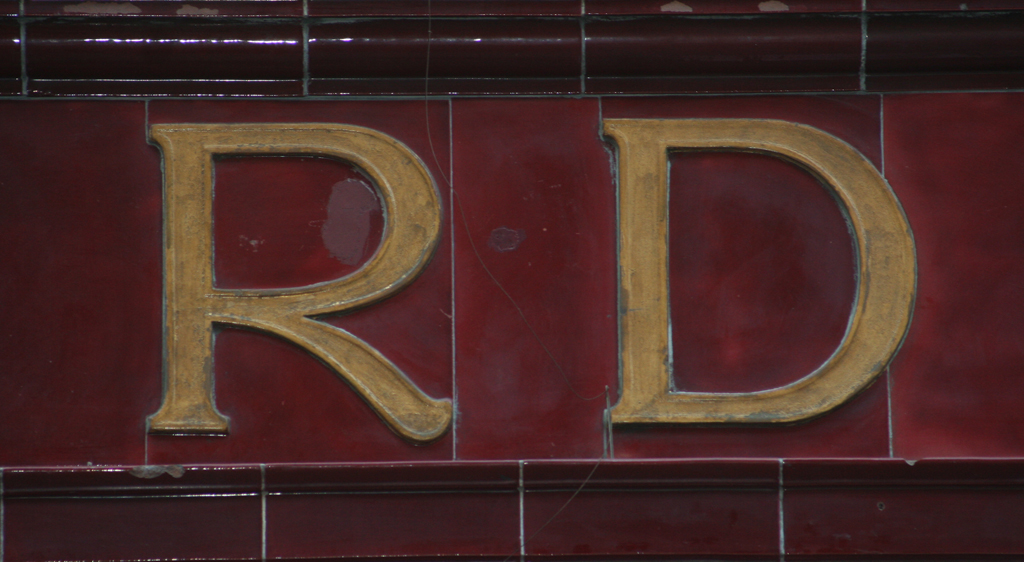 Detail of Oxford Circus Station sign (Soho, London). Photograph by Paul Shaw (2014).