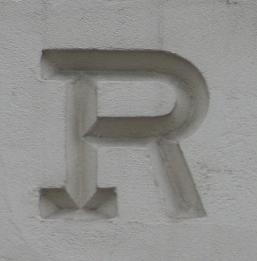 R from The Pharmaceutical Society of Great Britain building (Bloomsbury, London). Photograph 2014 by Paul Shaw.