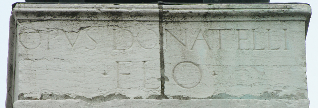 Signature of Donatello on base of the Statue of Gattamelata in front of S. Antonio (Padua). Photograph by Paul Shaw (2013).