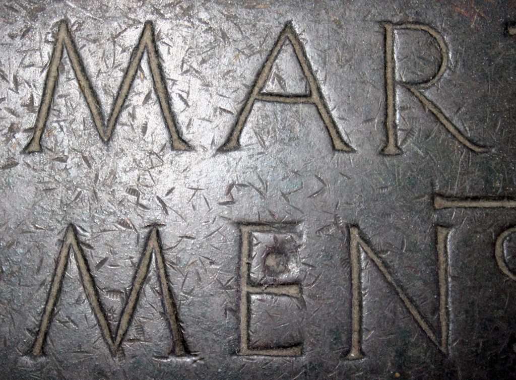 Fig. 15. Detail of the inscription at the base of the Tomb of Martin V (c.1445) in S. Giovanni in Laterano. Photograph by Paul Shaw (2013).
