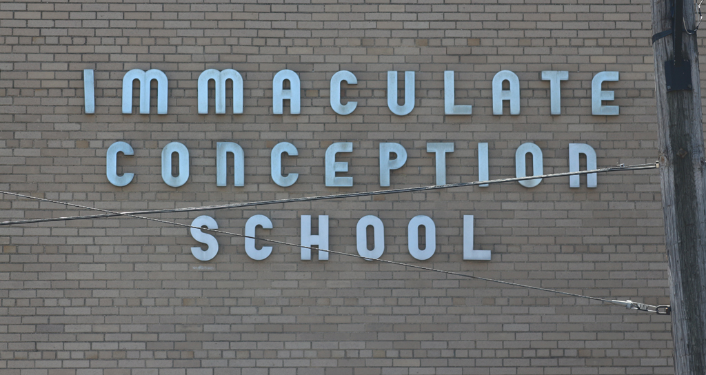 Signage on the front of Immaculate Conception School (1950)