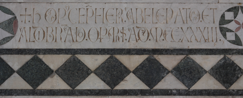 Inscription (1233) on the facade of the Duomo, Lucca.