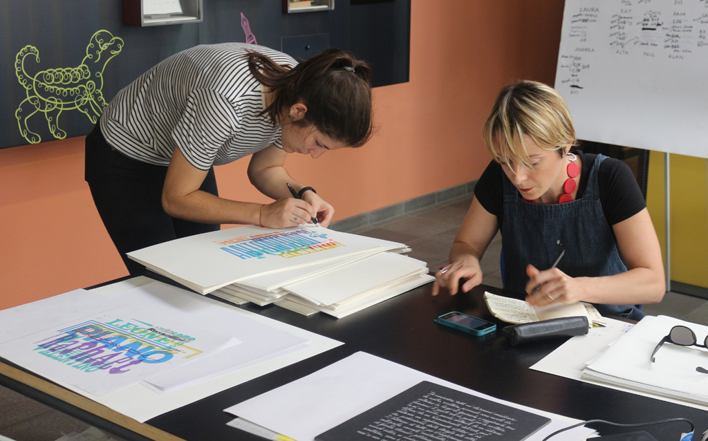 Alice Buda and Laura Dal Maso signing their prints at the end of the 2015 Legacy of Letters workshop. Photograph by Paul Shaw, 2015.