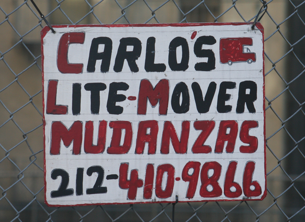 Sign for Carlo's Lite-Mover in Harlem.