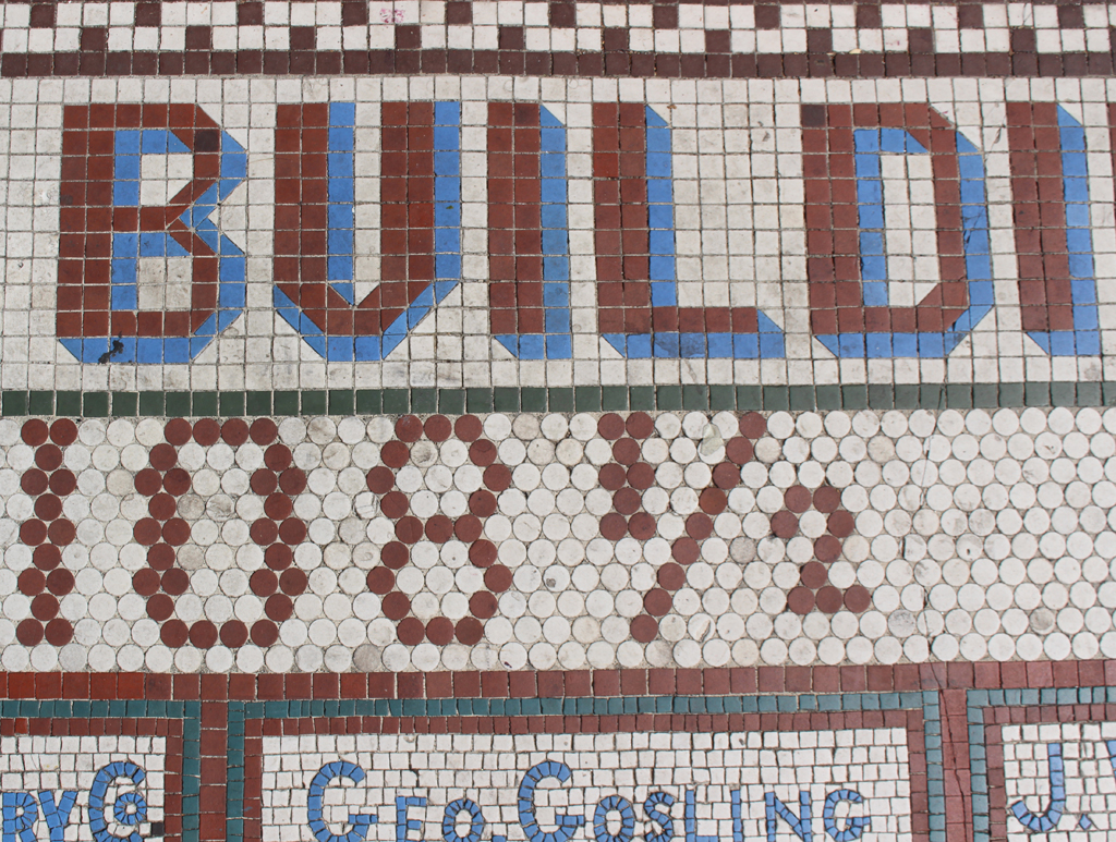 Detail of sidewalk tile sign for the Lippy Building, Seattle.