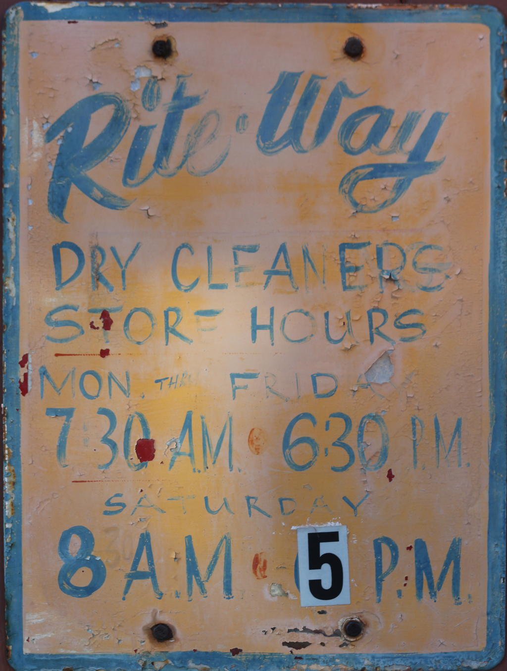 Rite-Way Dry Cleaners hours of operation sign. Cambridge, Massachusetts.