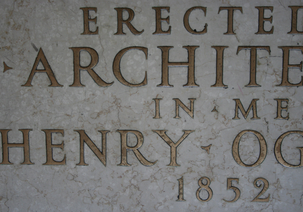 Detail of inlaid brass inscriptional letters in vestibule of Avery Library, Columbia University.