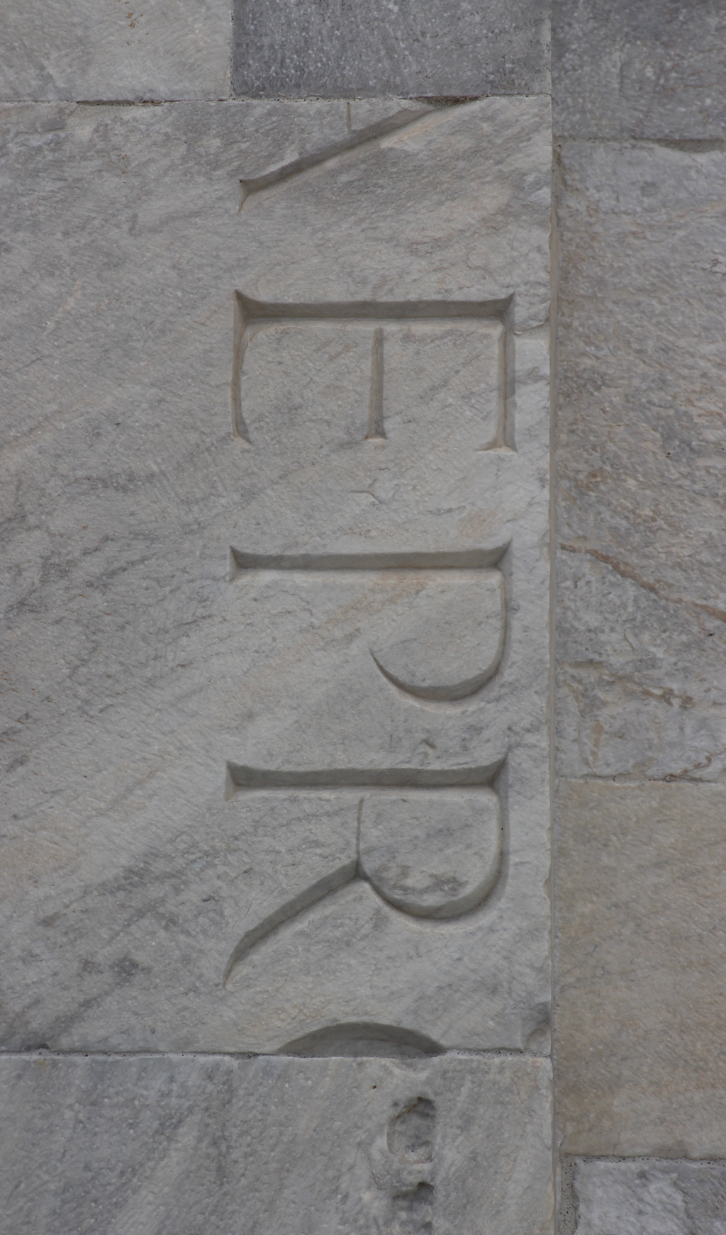 Spolia (reused stones) on the side of the Cattedrale, Pisa.