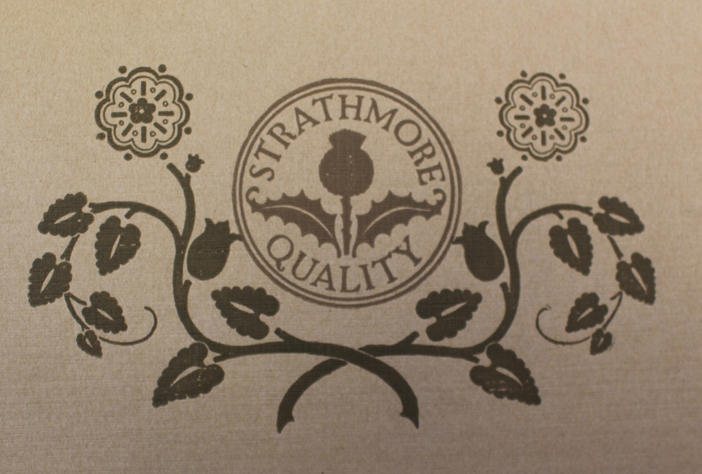 Detail of Strathmore Quality seal from back cover of Telanian Extra Super sample book (Strathmore Paper Co., 1912). Design by Will Bradley.