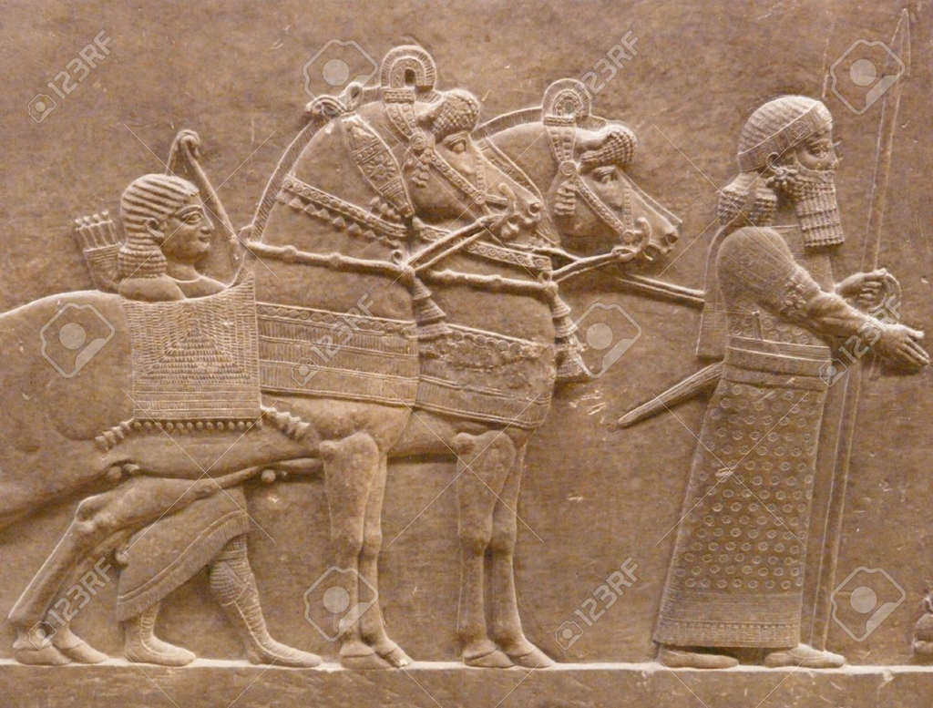 Ancient Assyrian wall carving of horses and men. From 123RTF stock photo website. Original source uncredited.