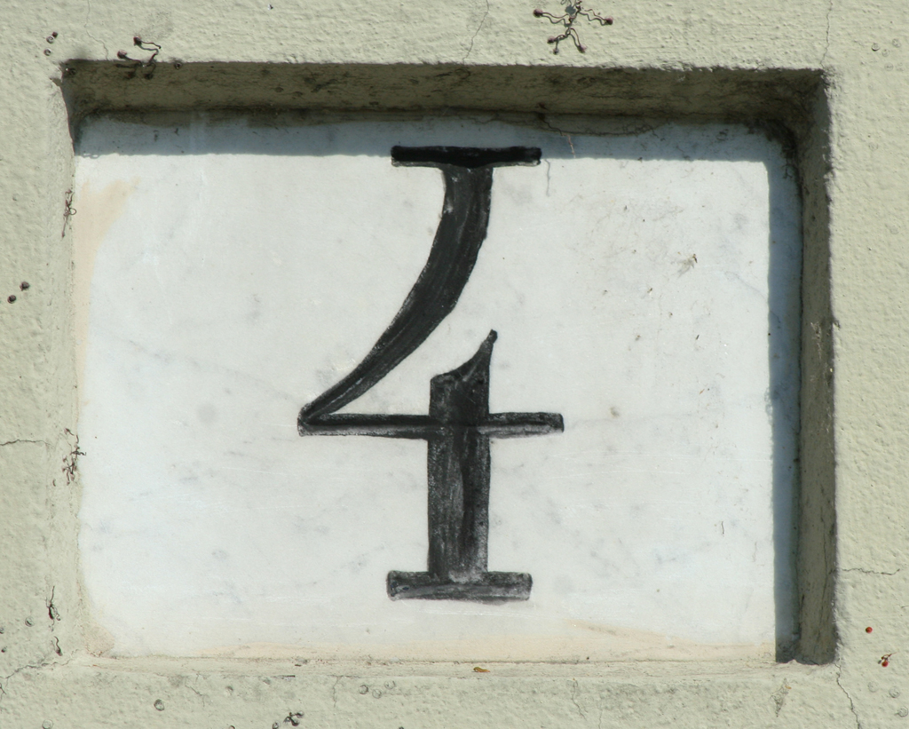 House number in Parma. Photograph by Paul Shaw (2013).